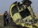 members-of-a-group-of-international-experts-inspect-the-territory-at-the-site-where-the-downed-malaysia-airlines-flight-mh17-crashed-near-the-village-of-hrabove