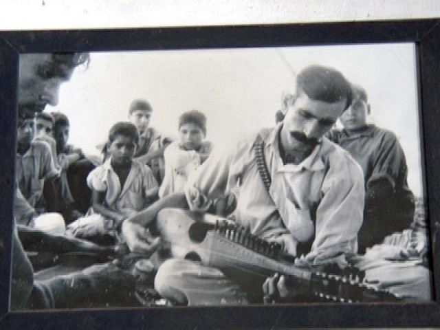 Dost Muhammad playing the rabab. PHOTO COURTESY: DOST MUHAMMAD