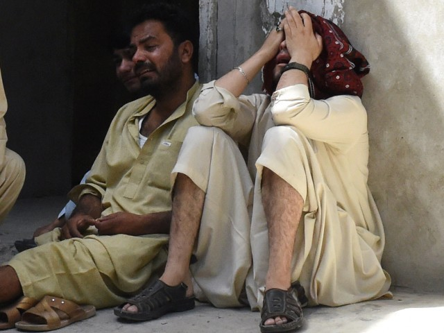 Relatives mourn the killing of Shia Muslims killed in an attack by gunmen at a hospital in Quetta on July 6, 2015. PHOTO: AFP