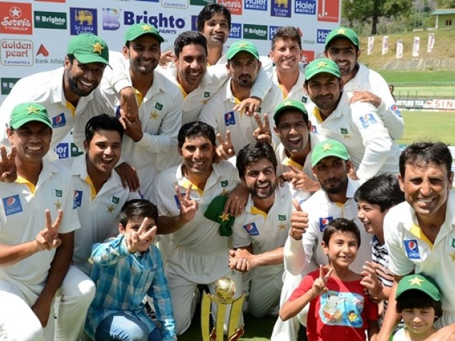 Pakistan cricketers pose after their team's series victory following the third and final Test cricket match between Sri Lanka and Pakistan at The Pallekele International Cricket Stadium in Pallekele on July 7, 2015. PHOTO:AFP