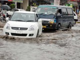 Vehicle moving through the standing water in Rawalpindi. PHOTO: ONLINE