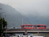 A Metro Bus moving on its track in Islamabad. PHOTO: ONLINE