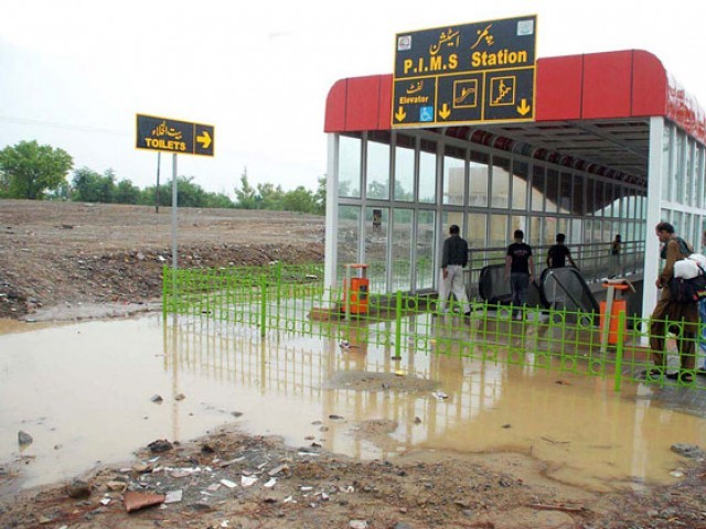 Water standing outside a Metro Bus station after monsoon rains in Islambad on Tuesday. PHOTO: ONLINE