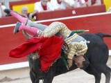 Spanish bullfighter Ivan Fandino is tossed during a bullfight at the San Fermin festival in Pamplona, July 10, 2015. PHOTO: REUTERS