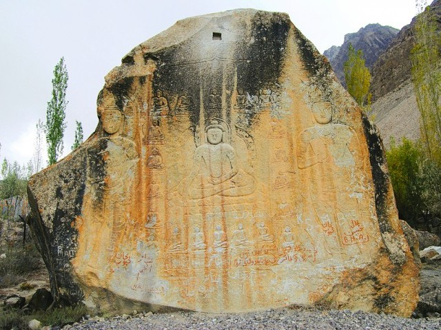 Images of Buddha in his different forms meticulously carved on a rock in Skardu. PHOTO COURTESY: BCDF