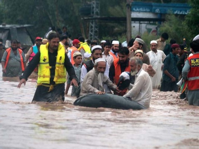 Rescue workers moving people from affected areas in Peshawar. PHOTO: MUHAMMAD IQBAL/EXPRESS