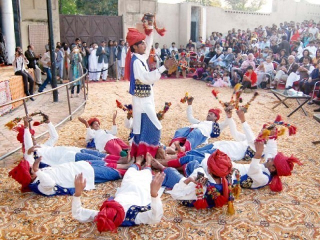 A file photo of Lok Virsa Mela from April 5th 2015, visitors enjoying a dance performance. PHOTO: MUHAMMAD JAVAID/EXPRESS