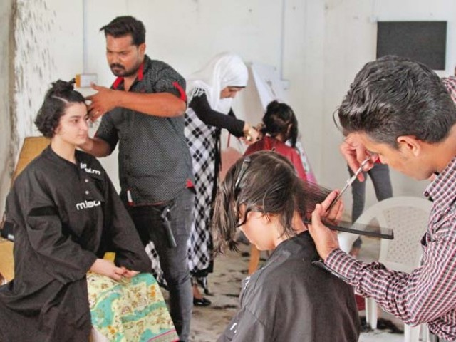 Volunteers donate hair for patients of cancer and other illnesses who lose hair during treatment. The Pakistan Youth Forum has undertaken the task of collecting donated hair to make wigs for such patients. PHOTO: AYSHA SALEEM/EXPRESS