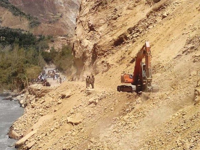 Frontier Works Organisation and Pakistan Army engineers work on Chitral-Boni Road. PHOTO COURTESY: ISPR