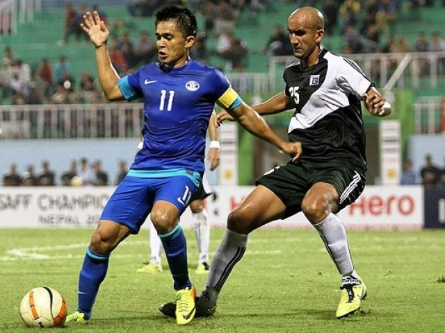 Indian captain Sunil Chhetri is tackled by former English Premier League player and current Pakistan International Zesh Rehman (R). Photo: GoalNepal.com