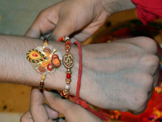 A girls ties a Rakhi onto her brother's wrist during Rakhsha Bandhan festival in Hyderabad on Saturday. PHOTO: INP