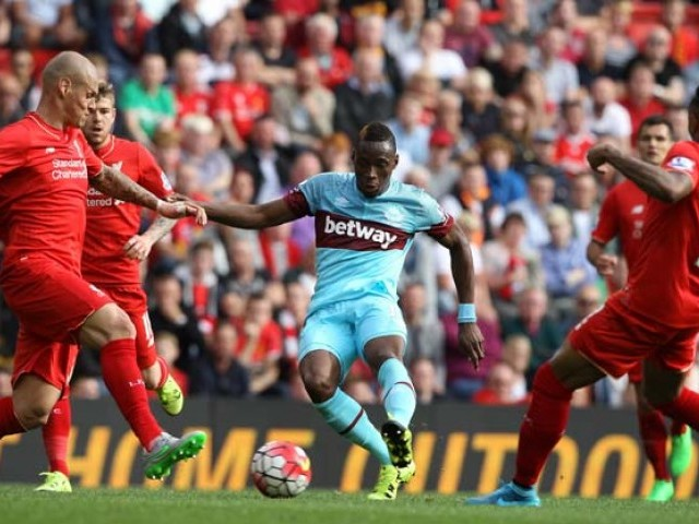 West Ham United's Senegalese striker Diafra Sakho (C) scores his team's third goal during the English Premier League football match between Liverpool and West Ham at the Anfield stadium in Liverpool, north-west England on August 29, 2015. PHOTO: AFP