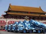 Military vehicles with shore-to-ship missiles drive past Tiananmen Gate during a military parade at Tiananmen Square in Beijing on September 3, 2015, to mark the 70th anniversary of victory over Japan and the end of World War II. PHOTO: AFP