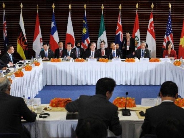 US President Barack Obama (3rd R) taking part in a meeting with leaders from the Trans-Pacific Partnership (TPP) at the US Embassy in Beijing in 2014. PHOTO: AFP