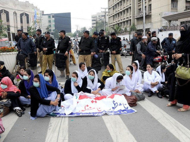 A file photo of lady health workers protesting. PHOTO: ZAHOOR UL HAQ/EXPRESS