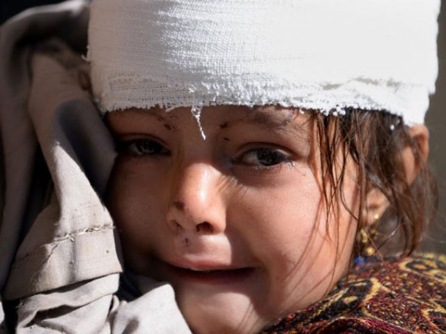A young girl weeps at a hospital in quake-hit Shangla, Pakistan, on October 28, 2015. PHOTO: AFP