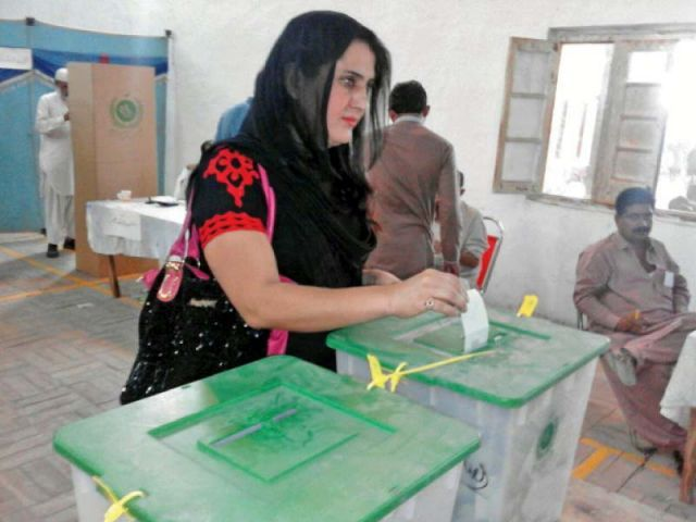 Sanam Fakir casts her vote in the Railway Officer's Club polling station on Saturday. PHOTO: EXPRESS