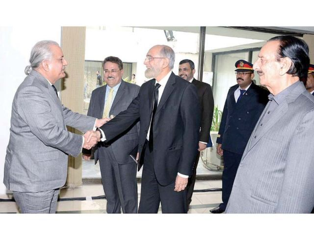 Raza Rabbani welcomes Anwar Zaheer Jamali at the Senate building. PHOTO: APP