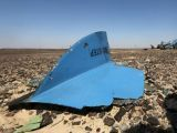 the-debris-from-a-russian-airliner-is-seen-at-its-crash-site-at-the-hassana-area-in-arish-city-2-2