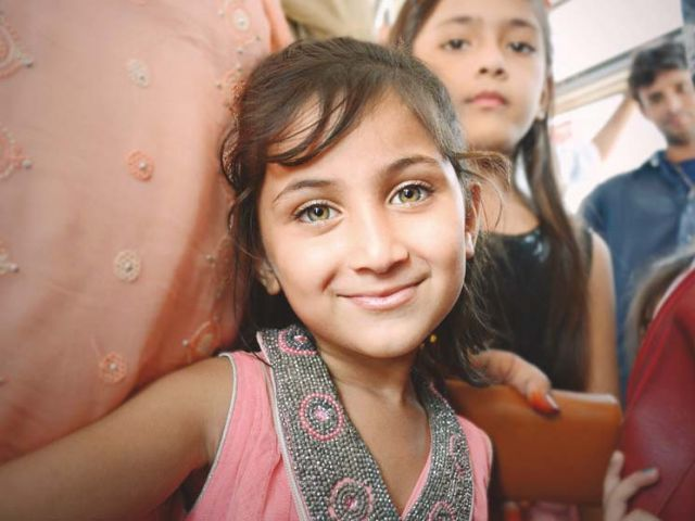 """Do you know my name means beautiful?"" Missel is on her way to a park in Saddar, Rawalpindi. ""I completed my homework on time this weekend because my parents promised to take me to the park. I haven't been on the swings in weeks."" PHOTOS : HUMA CHOUDHARY"
