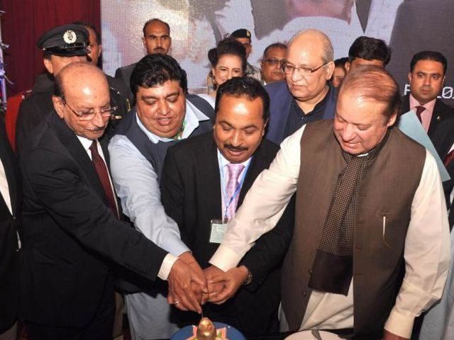Prime Minister Nawaz Sharif cuts a cake as part of the Diwali celebrations in Karachi on November 11, 2015. PHOTO: PID