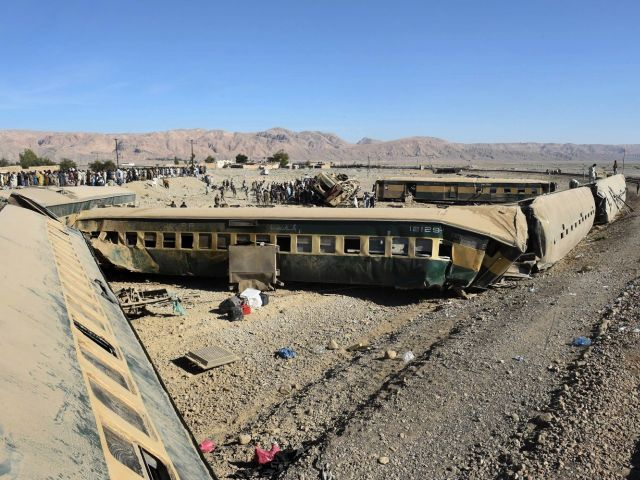 Security officials inspect damaged carriages following the derailment of a passenger train in Bolan district, some 75 kilometres from Quetta on November 17, 2015. PHOTO: AFP
