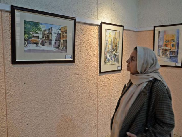 isitors appreciate Shabbier's work at the exhibition. PHOTO: MUHAMMAD IQBAL/EXPRESS