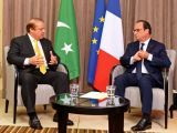 PM Nawaz talks with Francois Hollande during a meeting in Valletta. PHOTO: AFP