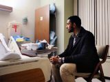 Wasiullah Mohamed, executive director of the Islamic Center of Pittsburgh, sits Friday with a taxi driver who was shot by a passenger last week. The victim, who asked not to be identified, said he was shot in the back for being Muslim. PHOTO: POST-GAZETTE