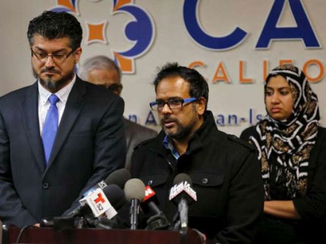 Farhan Khan (centre), brother-in-law of San Bernardino shooting suspect Syed Farook, speaks at the Council on American-Islamic Relations in Anaheim, California on Dec 2, 2015. PHOTO: REUTERS
