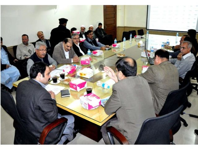 Senior Minister for Irrigation Sikandar Hayat Khan Sherpao being briefed about small dams in the province. PHOTO: EXPRESS