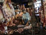 a-butcher-cuts-up-portions-of-beef-for-sale-in-an-abattoir-at-a-wholesale-market-in-mumbai-2-2