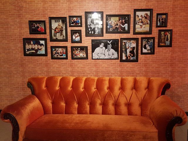 The café is fittingly filled with big orange couches, with cast photos hung up on red brick walls. PHOTO:AMEENA QAYYUM