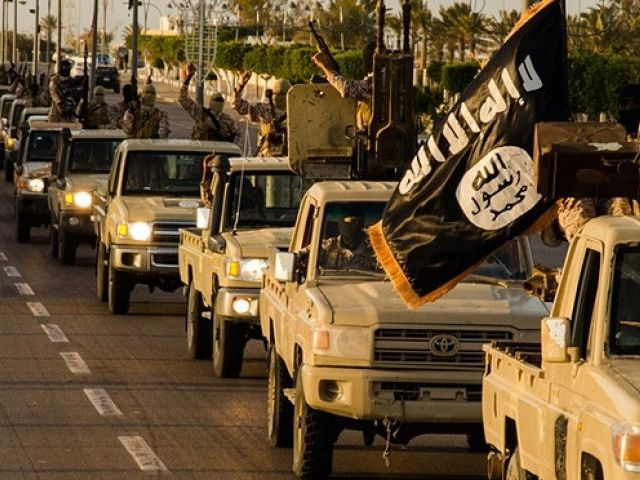 Islamic State fighters parade in Sirte, Libya, in early 2015. PHOTO: AFP