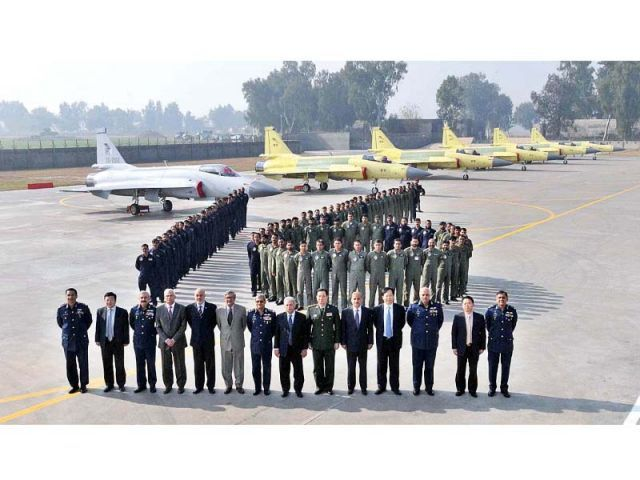 Minister for Defence Production Rana Tanveer and Chief of Air Staff Air Marshal Sohail Aman along with other senior officials pose for a group photograph at Pakistan Aeronautical Complex. PHOTO: APP