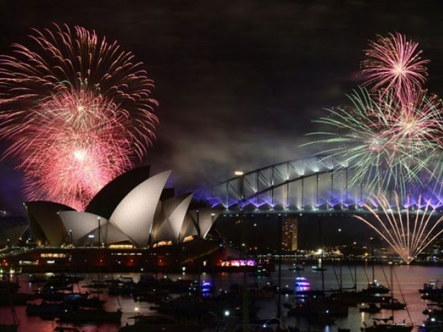 Fireworks light up the sky over Sydney's Opera House and Harbour Bridge during New Year celebrations in Sydney on January 1, 2016. PHOTO: AFP