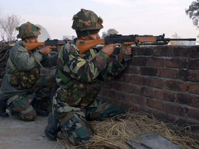 Indian army soldiers take up position on the perimeter of an airforce base in Pathankot on January 3, 2016. PHOTO: AF