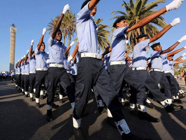 Police cadets parade during a graduation ceremony in Tripoli on June 8, 2015. PHOTO: AFP