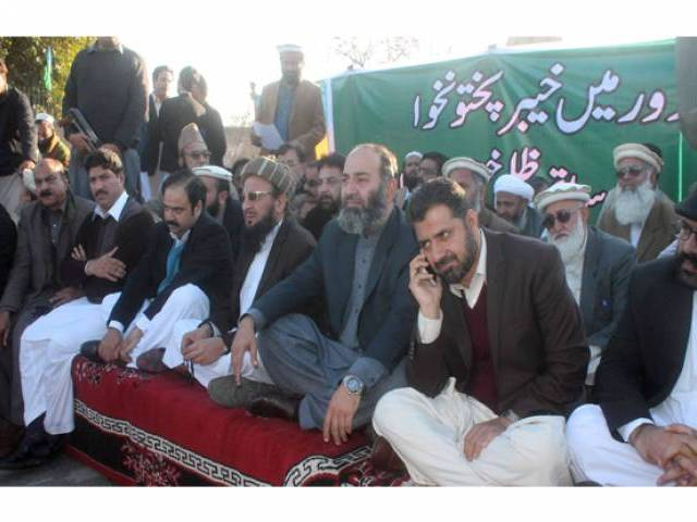 JI workers were led by provincial ameer Mushtaq Ahmad Khan. PHOTO: EXPRESS