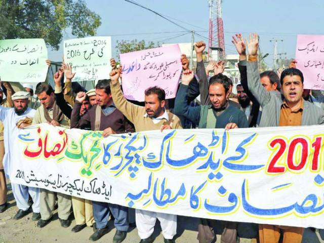 Members of ad hoc Lecturers Association protest at press club. PHOTO: PPI