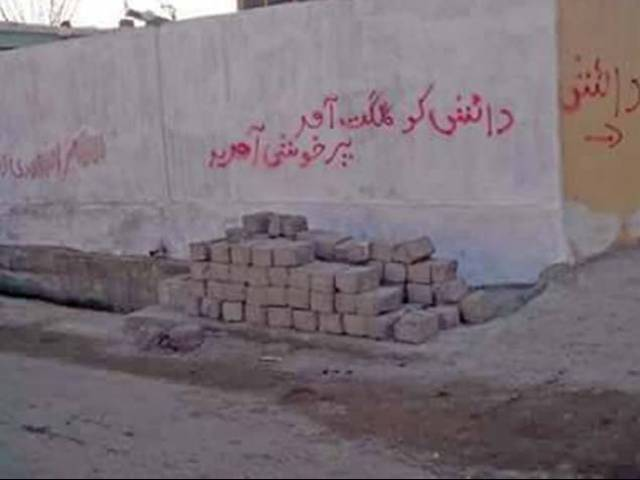 Wall chalking in Amphari area of Gilgit. PHOTO: EXPRESS