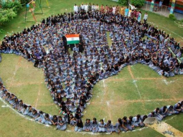 School girls form a shape of India as they pray for world peace at Jodhpur. PHOTO: REUTERS