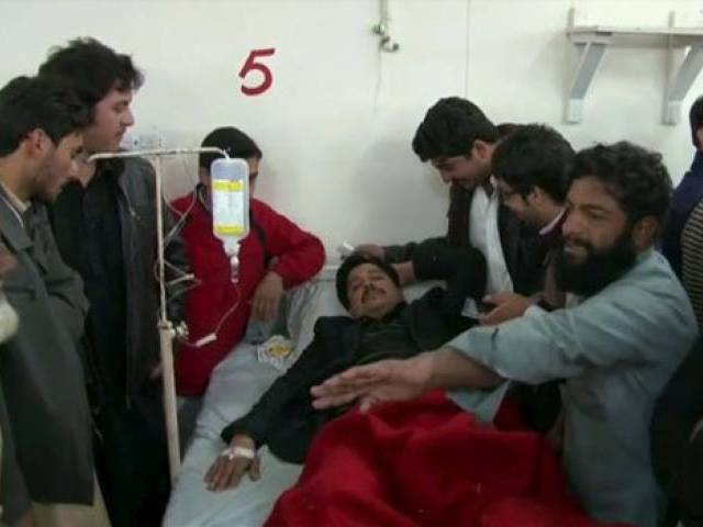 Relatives and friends surround a man, injured in a militant attack at the Bacha Khan University, at a hospital in Charsadda in this still image taken from a video on January 20, 2016. PHOTO: REUTERS