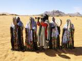 a-tuareg-band-performs-folkloric-songs-in-the-desert-during-the-19th-ghat-festival-of-culture-and-tourism-in-ghat