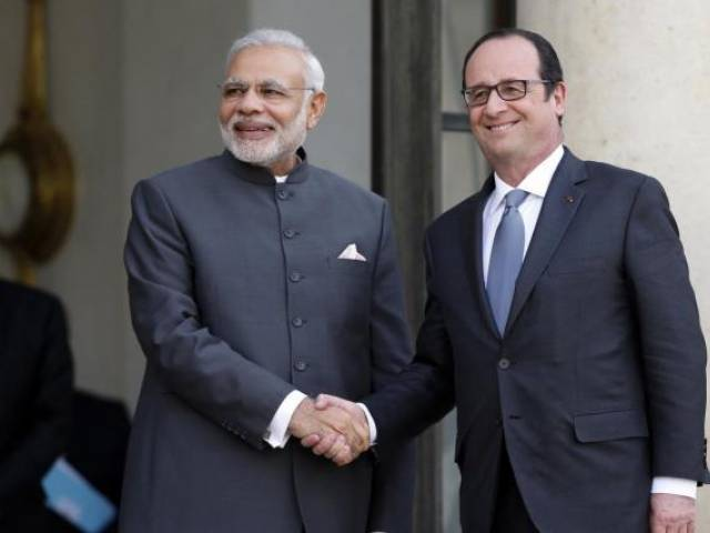 Indian Prime Minister Narendra Modi (L) is greeted by French President Francois Hollande (R). PHOTO: REUTERS