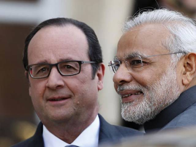 French President Francois Hollande (L) with Indian Prime Minister Narendra Modi (R). PHOTO COURTESY: INDIA TODAY