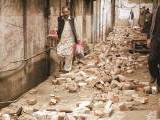 a-man-with-his-belongings-walks-past-the-rubble-of-a-house-after-it-was-damaged-by-an-earthquake-in-mingora-2