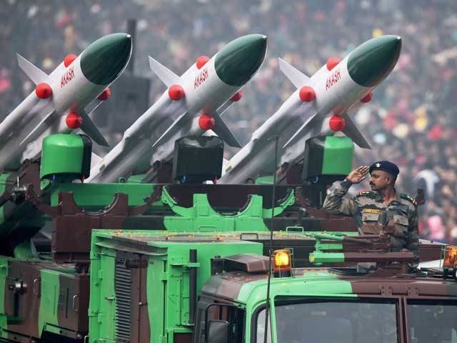 An Indian soldier salutes as he rides an Akash weapon system of air defence during India's Republic Day parade in New Delhi on January 26, 2016. PHOTO: AFP