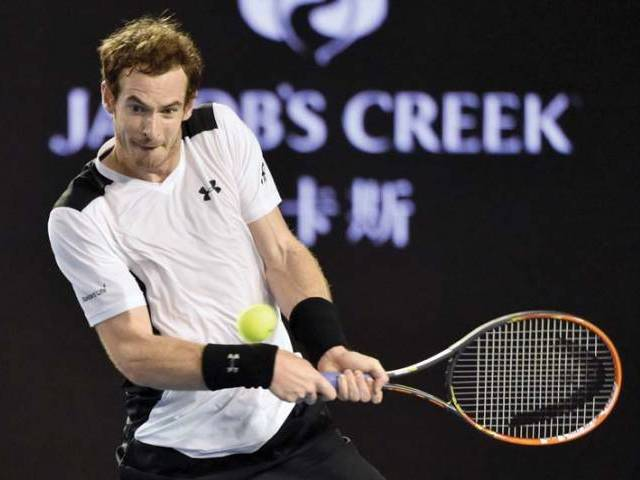 Murray appeared to benefit in the change to the slower court conditions when the roof was closed on Rod Laver Arena in the third set. PHOTO: AFP