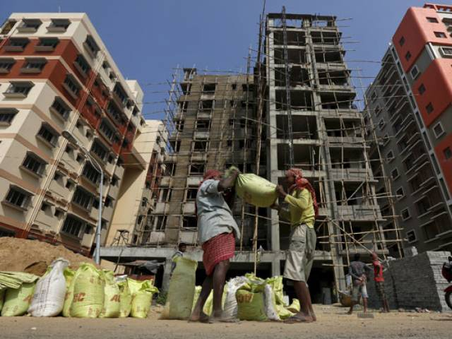 Labourers work at the construction site of a residential complex on the outskirts of Kolkata, India in this January 23, 2016 file photo. PHOTO: REUTERS